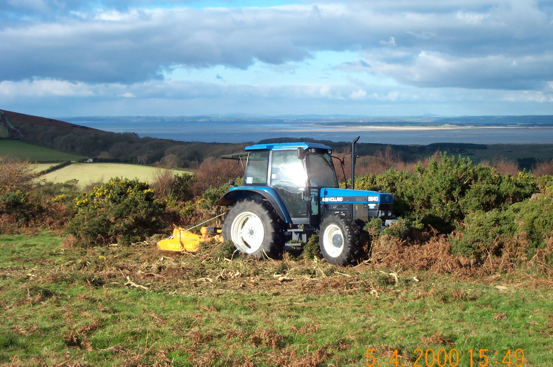 Ryers-tractor-swiping-gorse-gower-commons